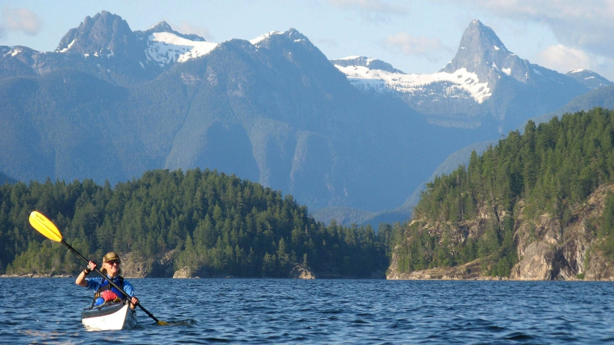 Connnie Sturgess of Calgary paddles her kayak through Desolation Sound, B.C., with the snow-capped Coast Mountains behind her, during a five-day kayaking trip through the region along the Sunshine Coast north of Vancouver, in this Aug. 2011 photo.
