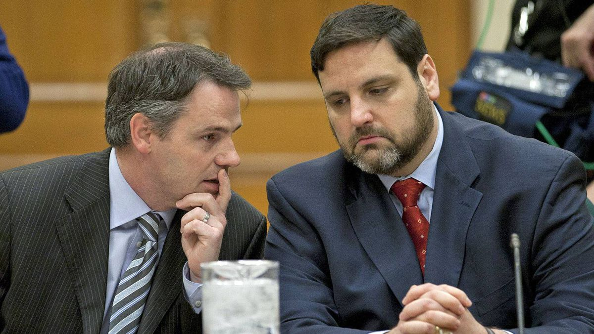 Former Liberal staffer Adam Caroll, right, listens to advice from his lawyer ahead of his testimony before the Commons ethics committee on April 24, 2012, about the Vikileaks Twitter account he created.