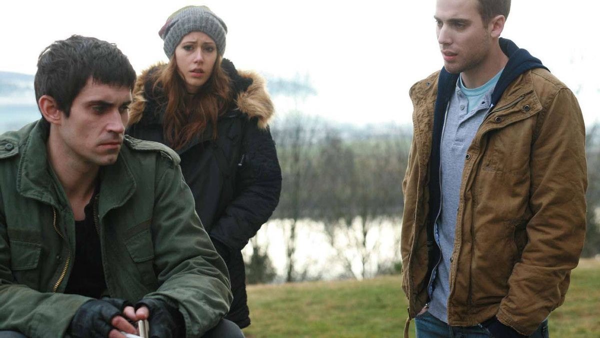 "Richard de Klerk, Amanda Crew, and Dustin Milligan in a scene from ""Repeaters""."