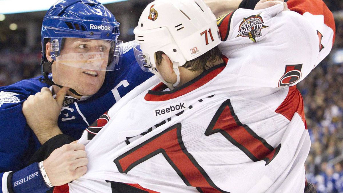 Toronto Maple Leafs captain Dion Phaneuf fights Ottawa Senator Nick Foligno in the second period in Toronto on Jan. 17, 2012.