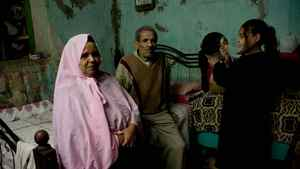 Mosad Abdulla Ibrahim, 78, his wife Hekmet Abdelsala, 65, and their grandaughter Shamie are residents of a poor district of Cairo's Sayeda Zeinab neighbourhood. They have only two complaints: their one-room home has no water, and the dilapidated roof leaks right over their bed.