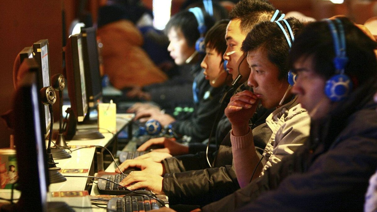In this photo taken Friday, Jan. 15, 2010, Chinese use computers at an Internet cafe in Fuyang in central China's Anhui province.