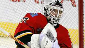Calgary Flames goalie Miikka Kiprusoff, from Finland, stops a shot during first period NHL hockey action against the Chicago Blackhawks in Calgary, Feb. 3, 2012.