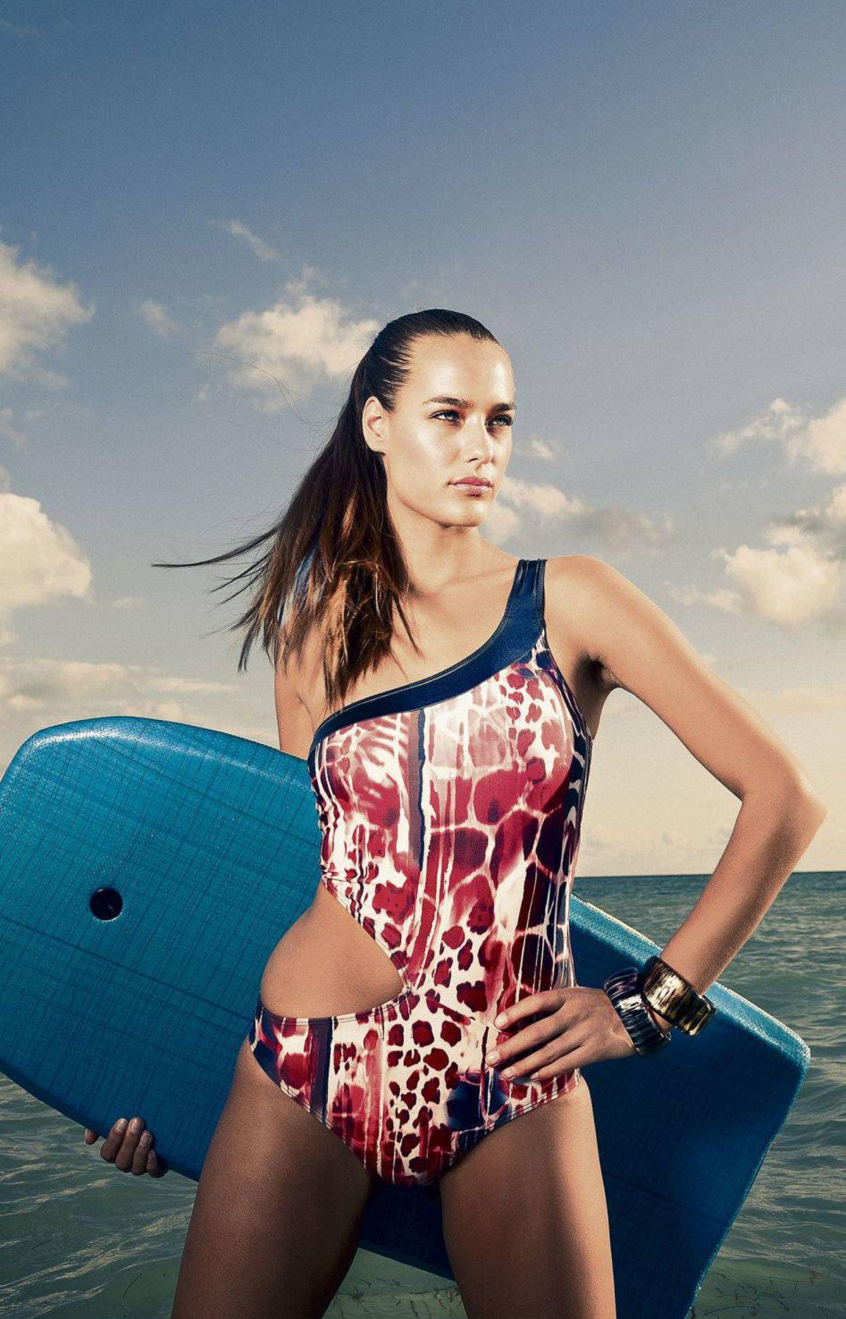 Aqua Di Lara swimsuit, $255. Esprit bangles, $29.50 each.