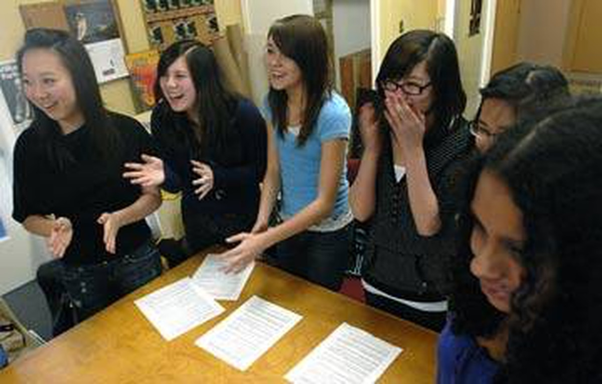 he Guelph Contemporary Dance Festival's volunteer applications doubled in 2009. Here, Kathy Chen, 17, Alexia Kuan, 14, Alisha Oliver, 14, Jessica Su, 14, Bernadette Cruz, 15, and Chantal D'Souza, 16, practice playing an 'ice breaker' game they will teach to campers.