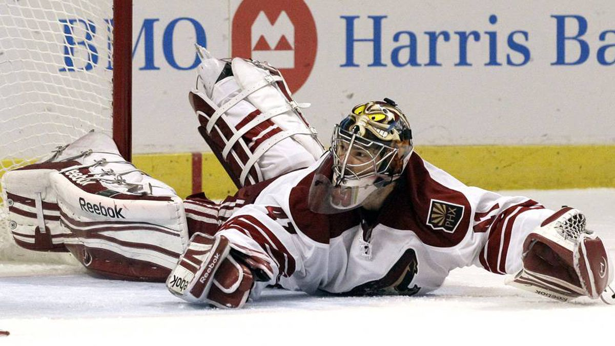 Phoenix Coyotes goalie Mike Smith blocks a shot against the Chicago Blackhawks during the second period of Game 6 of an NHL hockey Stanley Cup first-round playoff series in Chicago.