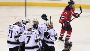 The Los Angeles Kings celebrate a goal by Colin Fraser (24) as New Jersey Devils' Zach Parise and Dainius Zubrus (bottom) skate away during the first period in Game 1 of their Stanley Cup final in Newark, New Jersey, May 30, 2012.