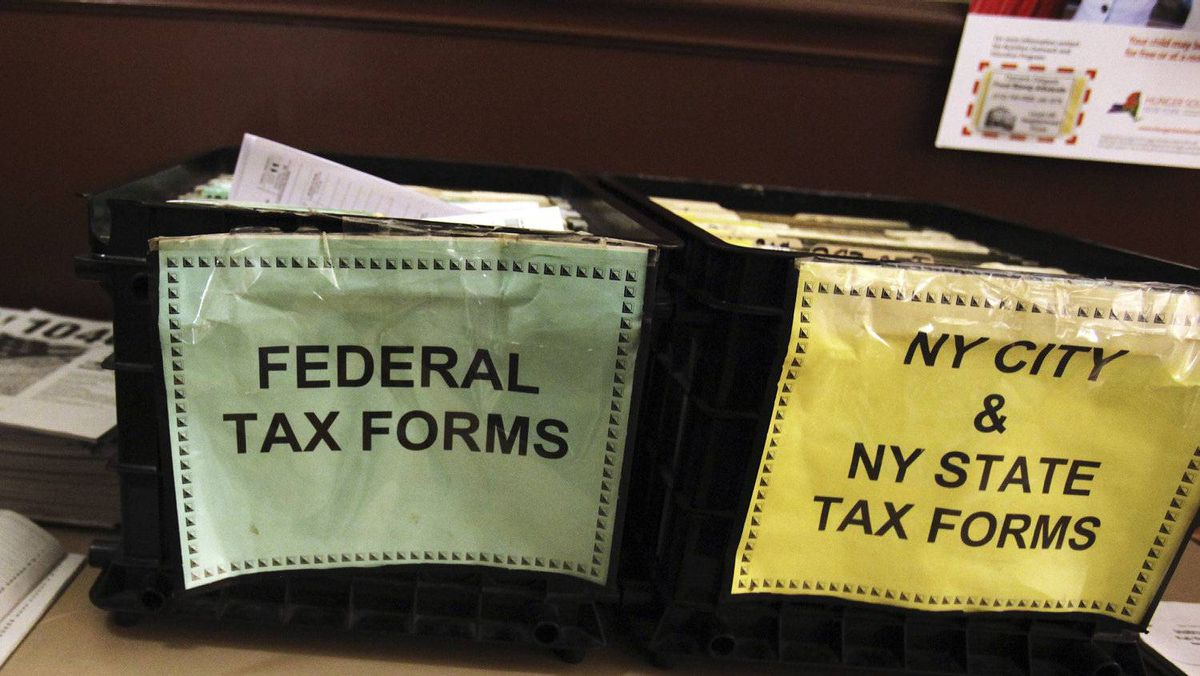 Crates filled with 2011 tax forms are seen at the 96th Street Public Library in New York, April 17, 2012.