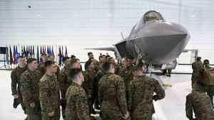 Naval flight students inspect a U.S. Marine F-35 Joint Strike Fighter jet during a roll-out ceremony at Eglin Air Force Base in Florida on Feb. 24, 2012.