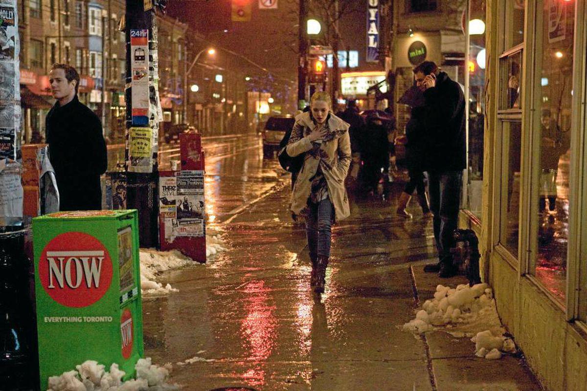 Amanda Seyfried, the titular character in Atom Egoyan's Chloe, walks down College Street in Toronto, where the film is set.