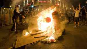 Protesters start a fire during a demonstration in Montreal, Saturday, May 19, 2012.