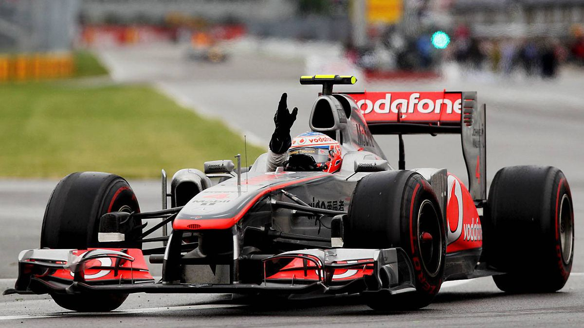 McLaren driver Jenson Button of Great Britain celebrates after winning the Canadian Formula One Grand Prix at the Circuit Gilles Villeneuve on June 12, 2011 in Montreal, Canada.