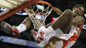 Toronto Raptors' Amir Johnson (top) celebrates his slam dunk over New York Knicks' Anthony Randolph during the first half of NBA pre-season action in Montreal, October 22, 2010. REUTERS/Shaun Best