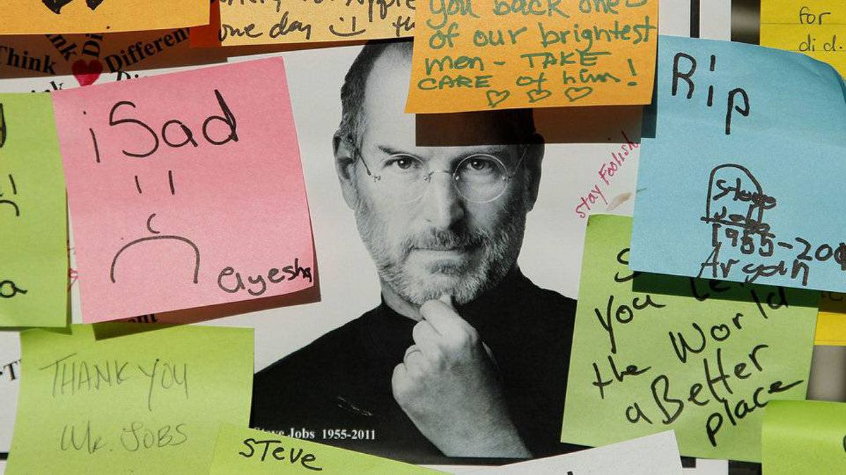 A photo of Steve Jobs is shown under notes written from supporters outside of an Apple store in Palo Alto, Calif., Wednesday, Oct. 19, 2011. Apple closed a number of its stores for a memorial service for co-founder and CEO Steve Jobs.