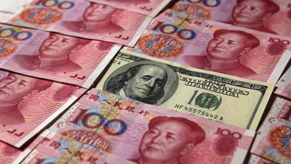 A U.S. $100 banknote is placed next to 100 yuan banknotes in this picture illustration taken in Beijing in this October 16, 2010 file photo. China took a milestone step in turning the yuan into a global currency on April 14, 2012, by doubling the size of its trading band against the dollar, pushing through a crucial reform that further liberalizes its nascent financial markets.