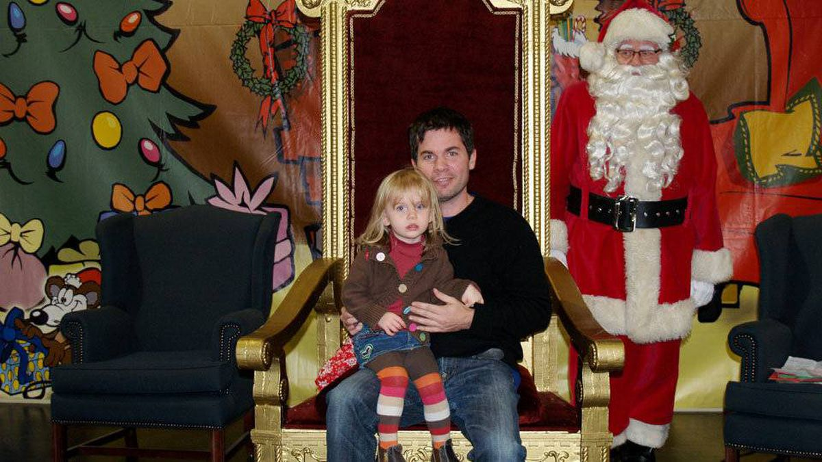 D'Arcy Finley writes: Here is Amelia Finley — aged 2 and a half — after ordering Santa off his throne and her dad onto it. Note Santa looking on resentfully from the side.