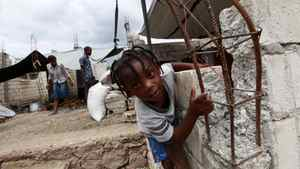 A young boy plays in a temporary camp for Jacmel residents displaced by Haiti's earthquake.