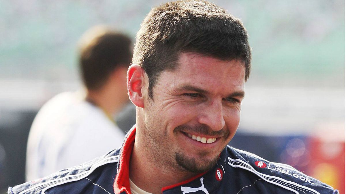 NASCAR Patrick Carpentier waits to qualify for the Camping World RV 400 auto race at Kansas Speedway in Kansas City, Kan., Friday, Sept. 26, 2008.