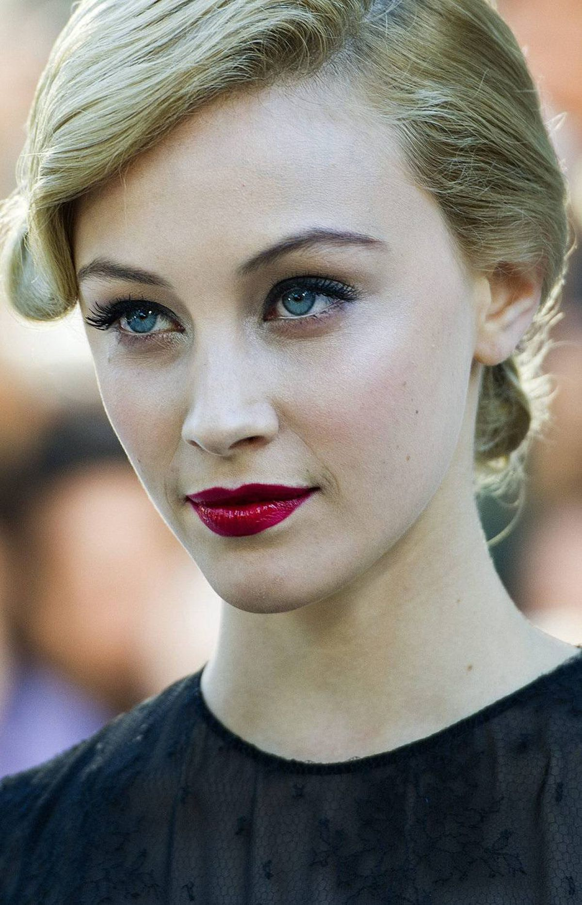 "Actress Sarah Gadon poses for a photograph on the red carpet before the screening of the new movie ""A Dangerous Method"" at the Toronto International Film Festival in Toronto on Saturday, Sept., 10, 2011."