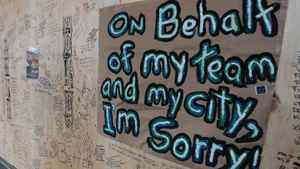 A message written on the plywood covering the windows of the damaged Hudson's Bay Company store in Vancouver, B.C., on Thursday June 16, 2011.