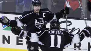 Los Angeles Kings' Dustin Brown (top) celebrates his empty net goal with teammate Anze Kopitar with less than a minute in the third period against the St. Louis Blues on the way to winning Game 4 of their NHL Western Conference semi-final playoff hockey game and the series in Los Angeles, California May 6, 2012. REUTERS/Danny Moloshok