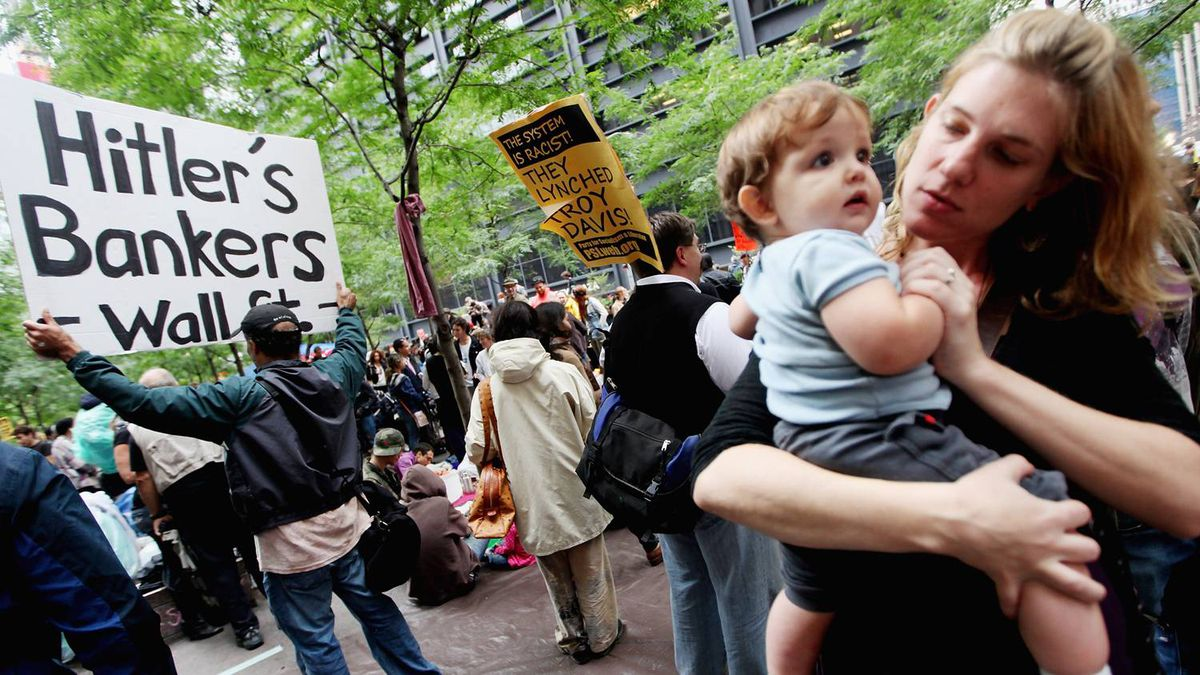 Supporters gather in Zuccotti Park along with members of the Occupy Wall Street movement before they marched to the Brooklyn Bridge on October 1, 2011 in New York City.