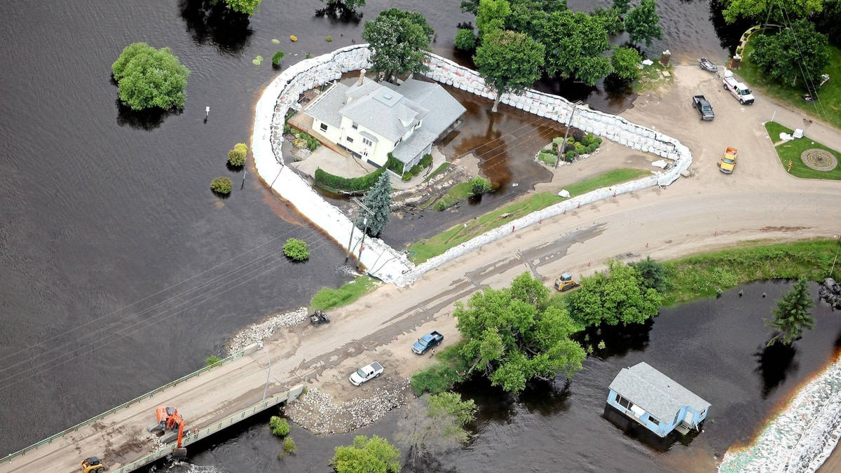 Homes are surrounded by water in Souris, Man. on Monday July 4, 2011.