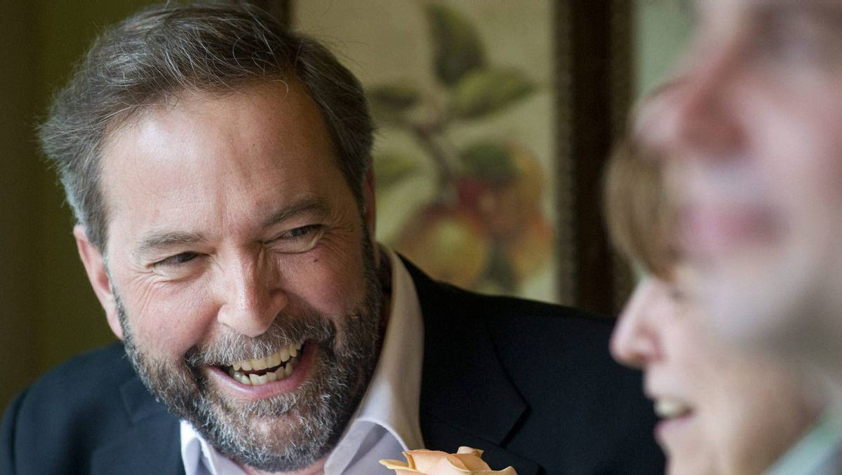 Thomas Mulcair, NDP deputy leader and candidate in the riding of Outremont, talks with a supporter during Canada's federal election day in Montreal, Monday, May 2, 2011.