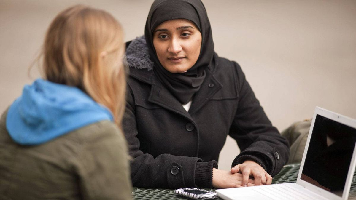 Awish Aslam, a political science student a the University of Western Ontario who was removed from a Conservative rally, speaks with a friend on campus in London on April 5, 2011.