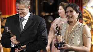 "Sharmeen Obaid-Chinoy (right) and Daniel Jung leave the stage after accepting the Oscar for best documentary short for ""Saving Face"" at the 84th Academy Awards on Sunday."