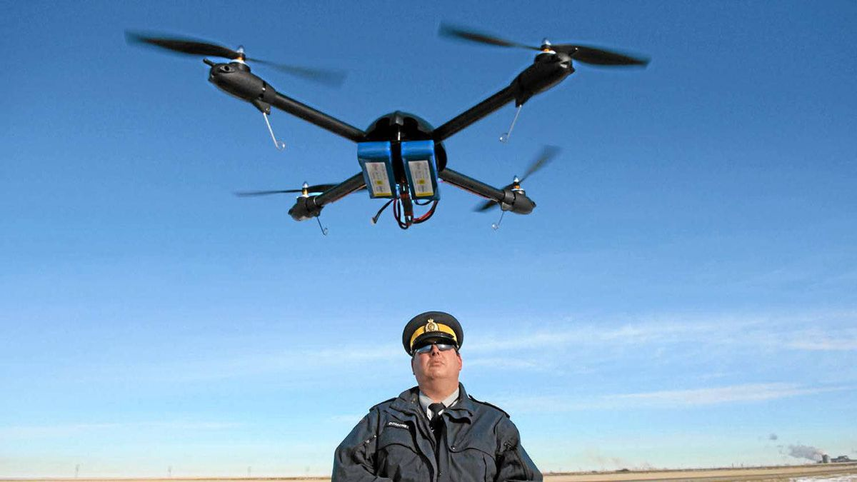 Sgt. Dave Domoney takes one of the RCMP's remote control helicopters for a spin above a farmer's field outside of Regina.