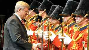 Prime Minister Stephen Harper greets band members during the opening of a performing-arts centre in Burlington, Ont., on Dec. 2, 2011.