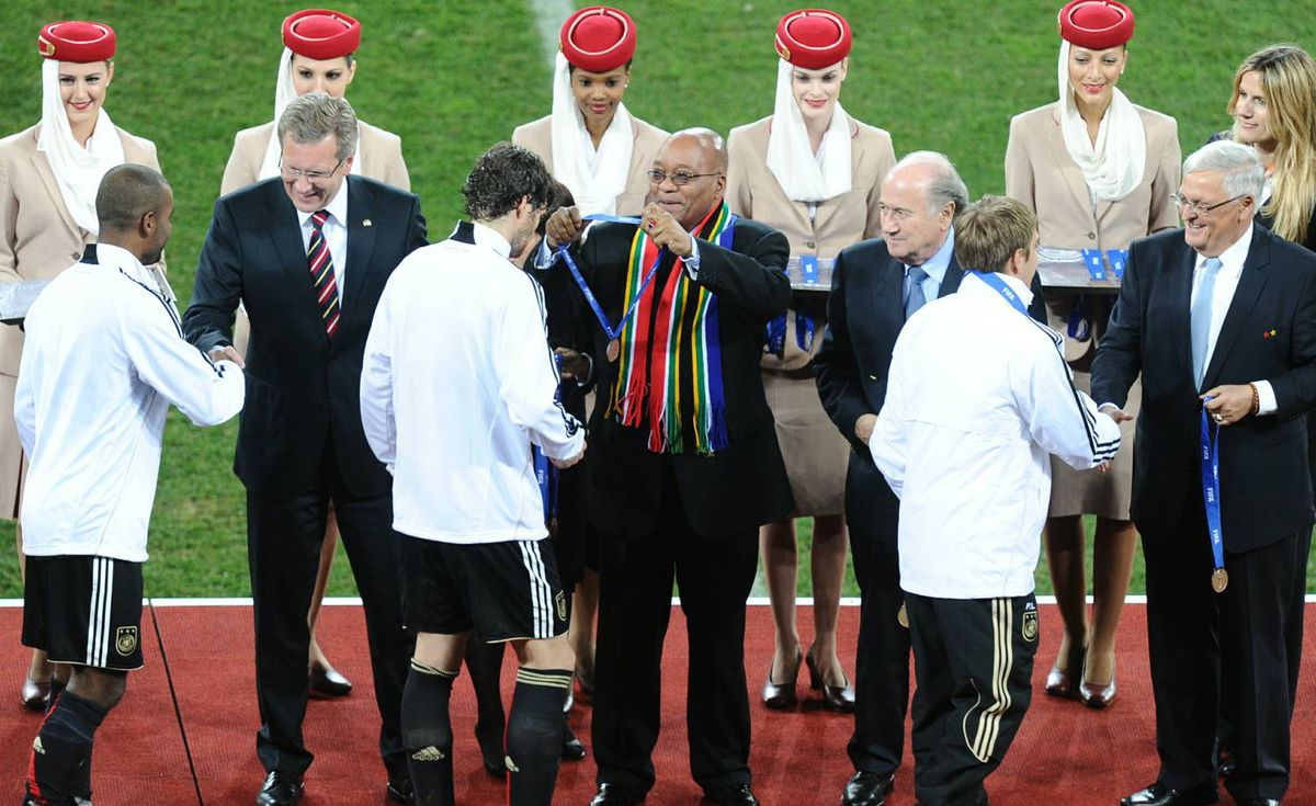 South African President Jacob Zuma (C), FIFA President Sepp Blatter (CR) and German President Christian Wulff (2ndL) present the third place medals to Germany's football squad at the end of the 2010 World Cup third place football match between Uruguay and Germany on July 10, 2010 at Nelson Mandela Bay Stadium in Port Elizabeth, South Africa. Germany won the match 3-2. Getty Images / CARL DE SOUZA