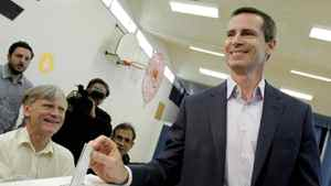 Liberal Leader Dalton McGuinty is accompanied by his wife Terri while casting his ballot in the provincial election at Featherston Public School in Ottawa Oct. 6, 2011.