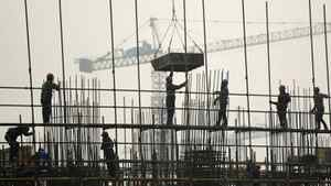 Labourers work on scaffolding at a residential construction site in Hefei, Anhui province, China, on March 6, 2012.
