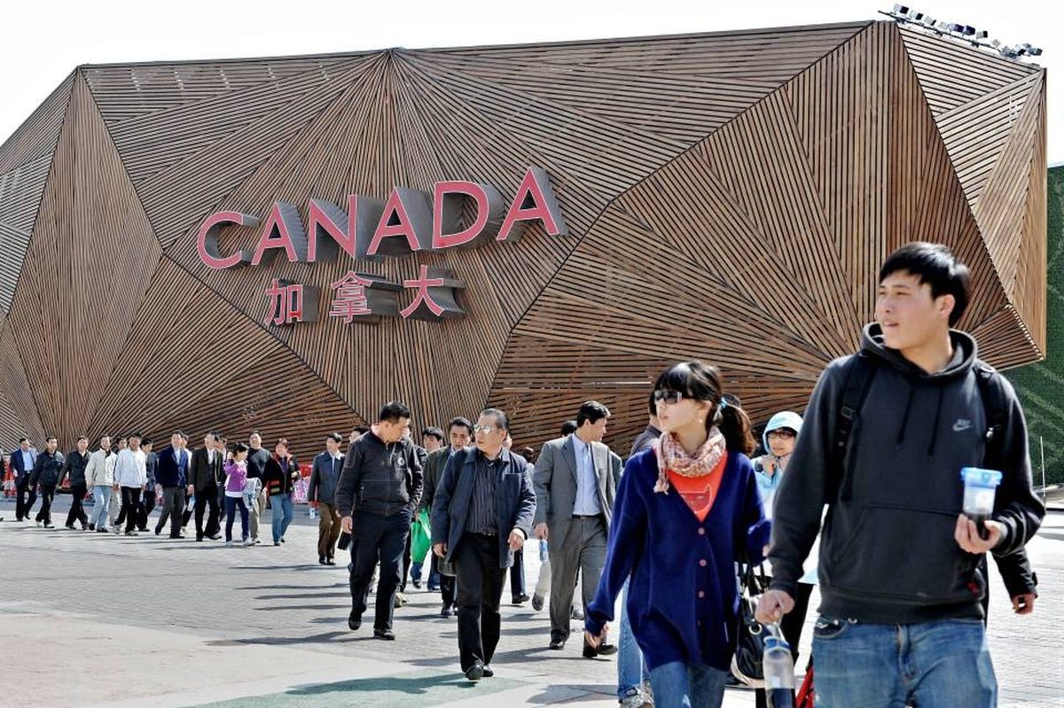 People walk past the Canadian pavilion at the site of the World Expo 2010 in Shanghai on April 29, 2010.