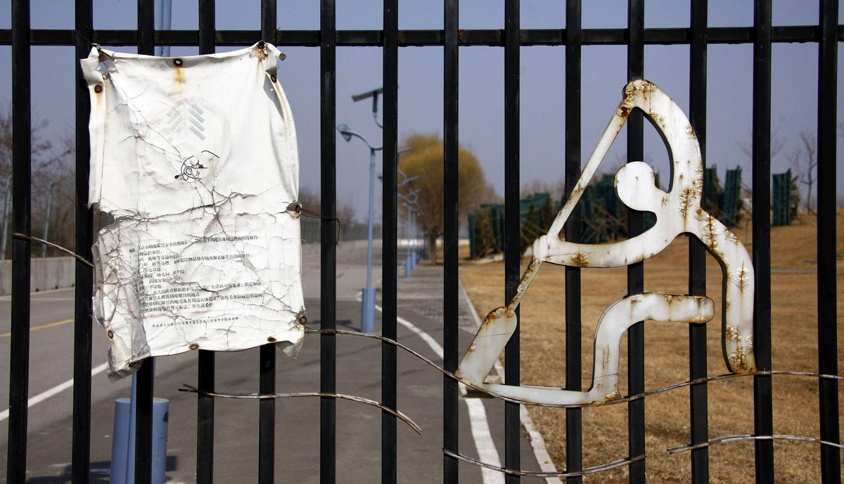 A weathered notice is seen on the main gate to the deserted and unmaintained former venue for the rowing and kayaking competitions of the 2008 Beijing Olympic Games, located on the outskirts of Beijing March 27, 2012.