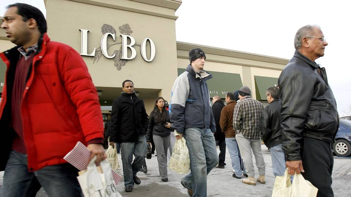 Patrons line up to get into an LCBO outlet as others leave after stocking up with their New Years eve beverages in Mississauga, Ont., in 2007.