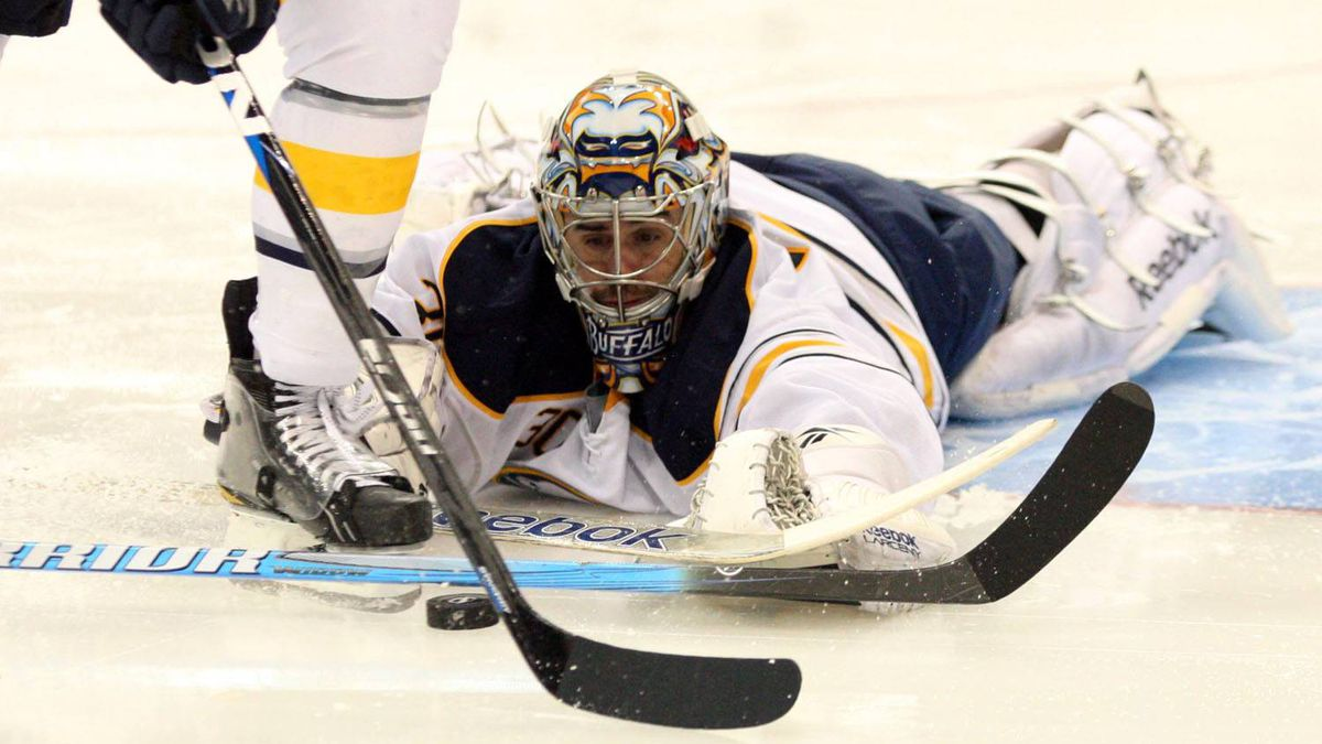 Buffalo Sabres goalie Ryan Miller (30) attempts to stop the puck shot by the Tampa Bay Lightning during the second period at St. Pete Times Forum. The Lightning won 3-0. Douglas Jones-US PRESSWIRE