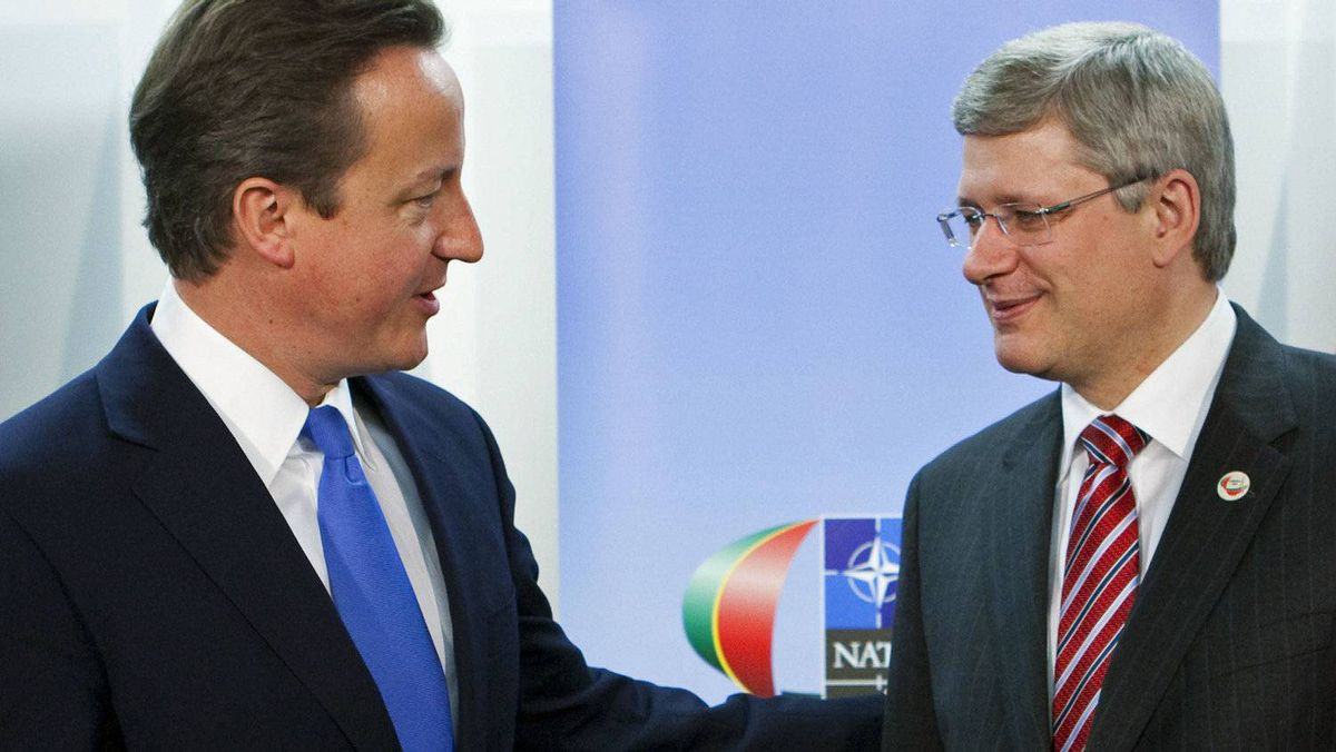 Prime Minister Stephen Harper meets British counterpart David Cameron at the NATO summit in Lisbon on Nov. 20, 2010.