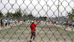Children take tennis lessons at Malvern Community Centre on Swells Road, Toronto, on July 7, 2011.