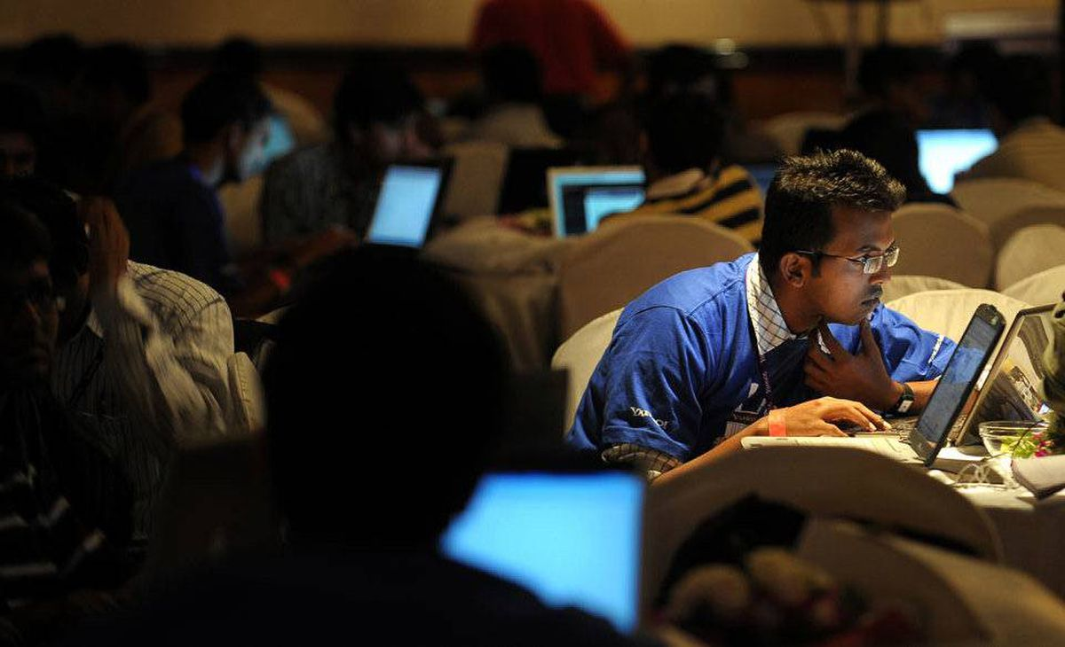 """The report also discussed the """"dark side of connectivity,"""" in which it highlighted the vulnerabilities of our digital infrastructure to cyber crime, espionage and plain mischief. In this file photo taken on July 25, 2010, Indian Information Technology (IT) professionals work on their laptops during an 'Open Hack Day' programme organised by the global search engine Yahoo! in Bangalore."""