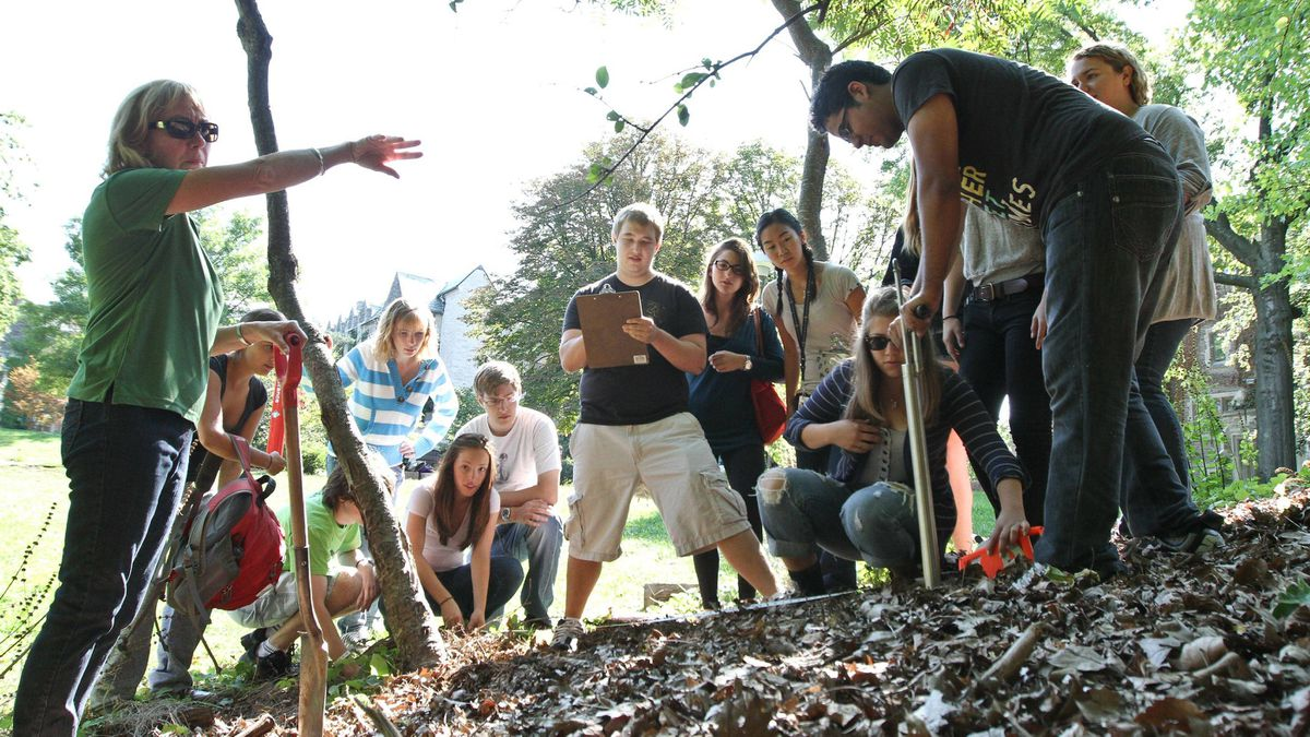 Carolyn Eyles, left, director of the integrated science program at McMaster University in Hamilton, Ont., along with her students take a soil sample from a ravine on campus. The iSci program often takes students outside the classroom to study and problem solve within several science fields, including geology, etymology and botany.