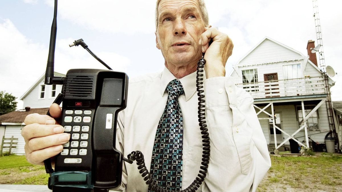 Victor Surerus demonstrates how he used his first cell phone, purchased in 1985 for roughly $1800.