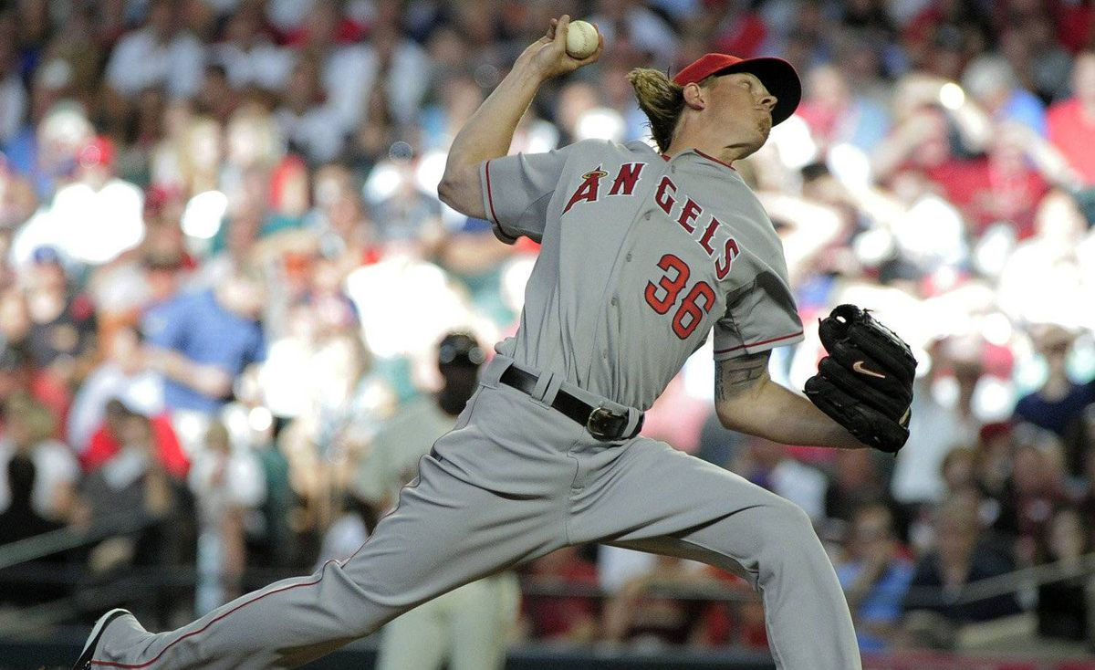 American League's Jered Weaver of the Los Angeles Angels throws during the first inning of the MLB All-Star baseball game Tuesday, July 12, 2011, in Phoenix.