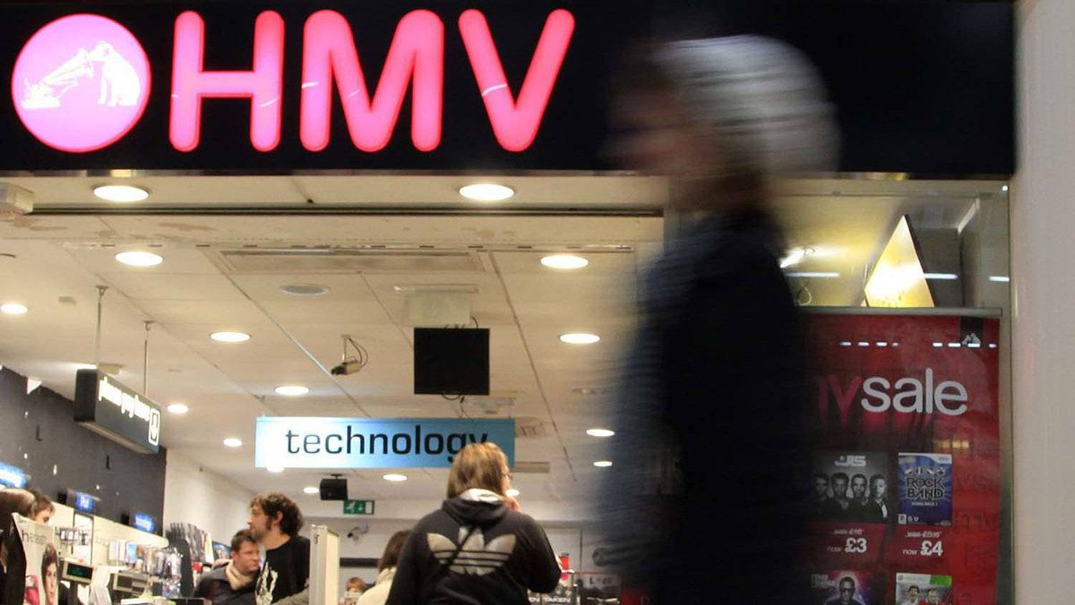 A shopper walks past a HMV store in central London January 5, 2011.