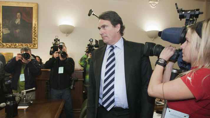 Pierre-Karl Peladeau, president of Quebecor, walks by media people to testify at a legislature committee on Labour Tuesday, February 1, 2011 at the legislature in Quebec City. A conflict at Le Journal de Montreal, where its employees are in a lock out, is in the centre of the discussion.
