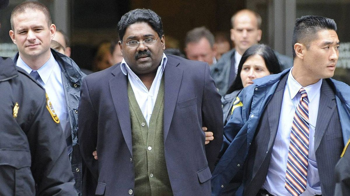 Raj Rajaratnam, billionaire founder of hedge fund the Galleon Group, is led in handcuffs from FBI headquarters in New York on Oct. 16, 2009. AP Photo/ Louis Lanzano