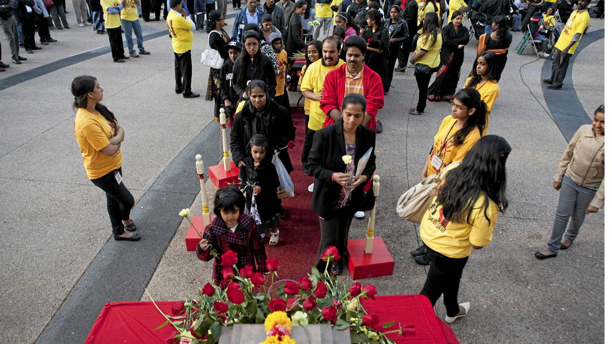 Members of Toronto's Tamil community lay down flowers in respect of those killed in the civil war in Sri Lanka. The community gathered for the third annual War Crimes Day on Friday, May 18, 2012