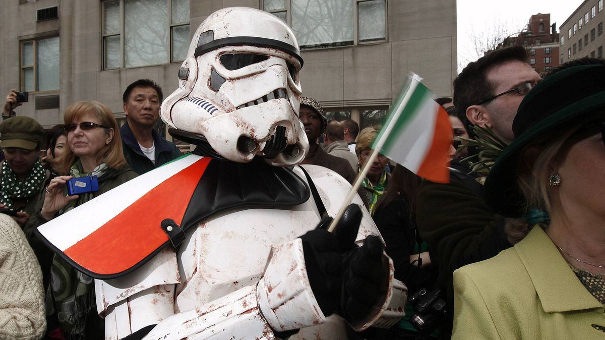 Knights of the Auld Republic: A costumed Imperial Stormtrooper watches the parade in New York on Saturday.